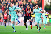 Callum Wilson of AFC Bournemouth middle battles with Sokratis Papastathopoulos of Arsenal right and Rob Holding of Arsenal during AFC Bournemouth vs Arsenal, Premier League Football at the Vitality Stadium on 25th November 2018
