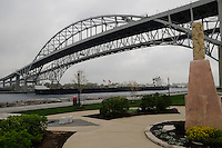 The Great Lakes ship H.L White passes under the Blue Water Bridges.