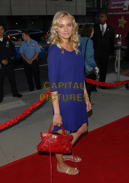 """DIANE KRUGER.attends The L.A. Special Screening of """"Sicko"""" held at The Academy of Motion Pictures Arts & Sciences in Beverly Hills, California, USA, June 26 2007.         .full length blue dress red Balenciaga bag silver fat sandals.CAP/DVS.©Debbie VanStory/Capital Pictures"""