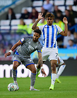 Lincoln City's Bruno Andrade shields the ball from  Huddersfield Town's Juninho Bacuna<br /> <br /> Photographer Andrew Vaughan/CameraSport<br /> <br /> The Carabao Cup First Round - Huddersfield Town v Lincoln City - Tuesday 13th August 2019 - John Smith's Stadium - Huddersfield<br />  <br /> World Copyright © 2019 CameraSport. All rights reserved. 43 Linden Ave. Countesthorpe. Leicester. England. LE8 5PG - Tel: +44 (0) 116 277 4147 - admin@camerasport.com - www.camerasport.com