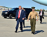 WEST PALM BEACH, FL - FEBRUARY 17: U.S. President Donald J. Trump walk with a military soldier as he arrives on Air Force One at the Palm Beach International airport as they prepare to spend part of the weekend at Mar-a-Lago resort on February 17, 2017 in West Palm Beach, Florida. After touring and meeting with Dennis Muilenburg Chairman of the Board, President, and CEO of the Boeing Company in North Charleston, South Carolina.  President Trump schedule to hold a campaign rally tomorrow at Melbourne Florida. ( Photo by Johnny Louis / jlnphotography.com )