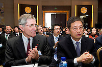 GDF Suez CEO and Paris Europlace Chairman Gerard Mestrallet (left), and Vice Mayor of Shanghai Tu Guangshao (right), at Shanghai / Paris Europlace Financial Forum, in Shanghai, China, on December 1, 2010. Photo by Lucas Schifres/Pictobank