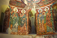 Apse of Saint Peter de la Seu d'Urgell<br /> <br /> Second quarter of the twelfth century<br /> Fresco transferred to canvas<br /> From the church of St. Peter currently dedicated to St. Michael and St. Peter Cathedral group of Seu d'Urgell (Alt Urgell)<br /> <br /> Acquisition of the Museum Board Campaign 1919-1923<br /> MNAC 15867<br /> <br /> <br /> The apse is the most important part of the church as it was where the altar was located. The apse of La Seu d'Urgell like most Romanesque apses was decorated with frescoes of a Theophany (referring to images of the Incarnation of Jesus).High up in the semi circular cupola of the apse is a large image of Christ in Majesty, or Christ Pantocrator, in a mandorla, a pointed verticle oval shaped aureola which surrounds the figures of Christ and the Virgin Mary in traditional Christian art.  This is flanked by Tetramorph showing the four evangelical symbols - St Matthew the man, St Mark the lion, St Luke the ox, and John the eagle. In the middle register is are a series of  frescoes of the Apostles and the figure of Mary. The lower register, which has not been preserved, must have been painted curtains that imitated luxury fabrics.