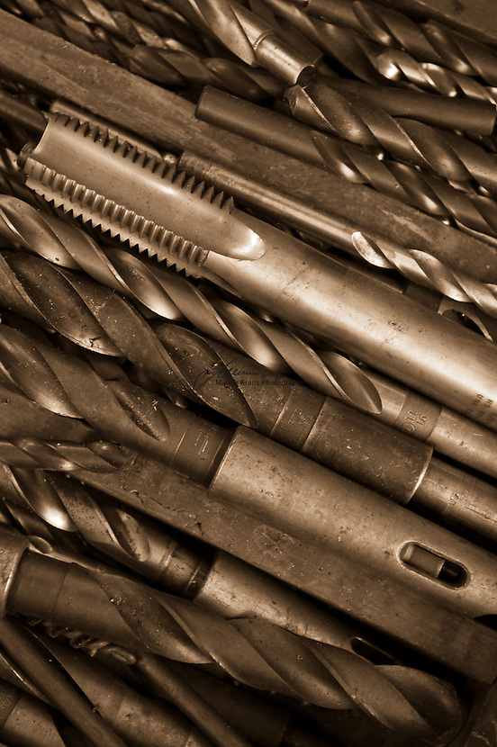 An assortment of drill bits and other industrial tool bits.