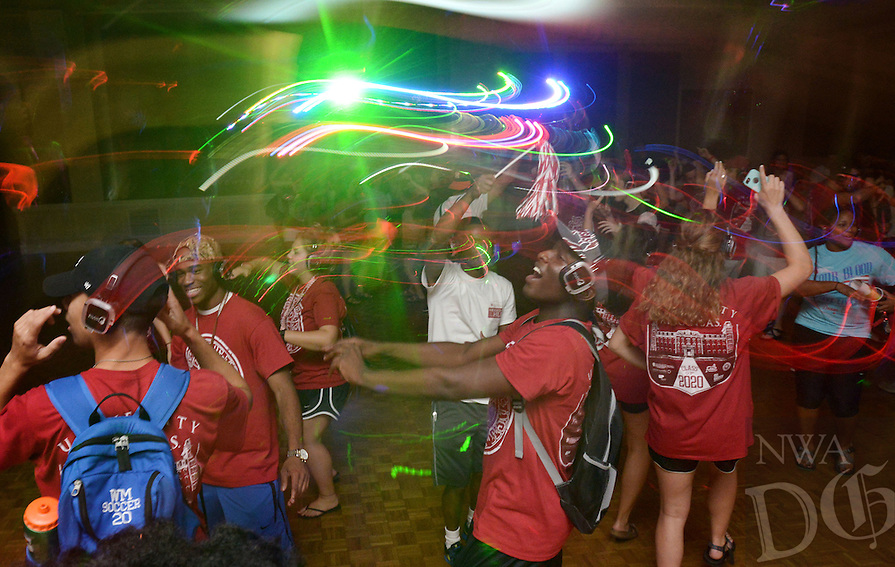 NWA Democrat-Gazette/BEN GOFF @NWABENGOFF<br /> Freshman students dance at a silend disco (where the music is played over headphones) on Sunday Aug. 21, 2016 during the University of Arkansas New Student Welcome After Party at the Arkansas Union in Fayetteville.