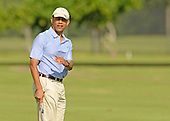 United States President Barack Obama lines up his putt on the 2nd green while golfing with the Prime MInister John Key of New Zealand at Marine Corps Base Hawaii's Kaneohe Klipper Golf Course, Kaneohe, Hawaii, January 2, 2014. <br /> Credit: Cory Lum / Pool via CNP