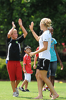 Kids celebrate scoring a goal during the Women's Professional Soccer (WPS) All-Star Fan Fest at Centennial Olympic Park in Atlanta, GA, on June 28, 2010.