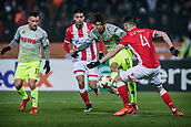7th December 2017, Rajko Mitic Stadium, Belgrade, Serbia, UEFA Europa League football, Red Star Belgrade versus FC Cologne; Midfielder Damien Le Tallec of Red Star Belgrade tries to block the shot from Forward Yuya Osako of FC Koeln