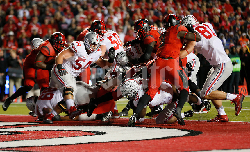 Ohio State Buckeyes running back Ezekiel Elliott (15) rushes for a short touchdown in the first quarter of the college football game between the Rutgers Scarlet Knights and the Ohio State Buckeyes at High Point Solutions Stadium in Piscataway, NJ, Saturday night, October 24, 2015. As of half time the Ohio State Buckeyes led the Rutgers Scarlet Knights 21 - 0.(The Columbus Dispatch / Eamon Queeney)