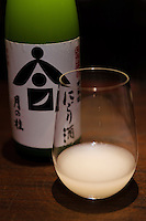 "Daigoku Jounakagumi Nigori Sake. Tsukinokatsura sake brewery, Fushimi, Kyoto, Japan, October 10, 2015. Tsukinokatsura Sake Brewery was founded in 1675 and has been run by 14 generations of the Masuda family. Based in the famous sake brewing region of Fushimi, Kyoto, it has a claim to be the first sake brewery ever to produce ""nigori"" cloudy sake. It also brews and sells the oldest ""koshu"" matured sake in Japan."