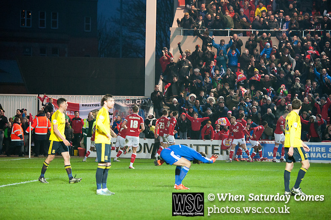 Bristol City 1 Middlesbrough 0, 16/01/2016. Ashton Gate, Championship. Bristol City players celebrate Wes Burns winning injury time goal while Boro keeper Dimi Konstantopoulos smacks the floor in frustration during the game between managerless Bristol City and Championship leaders Middlesbrough. Ashton Gate is located in the south-west of the city, it currently has an all-seated capacity of 16,600, due to redevelopment, which will increase to a capacity of 27,000 by the start of the 2016-17 season. Bristol City won the game one goal to nil with a headed injury time winner. Photo by Simon Gill