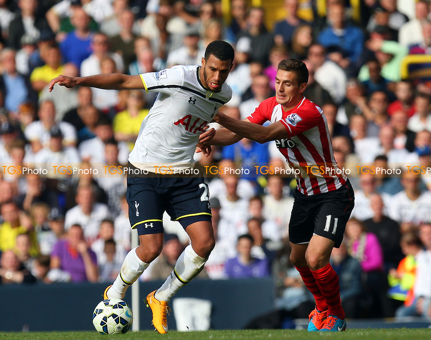 Nacer Chadli of Tottenham Hotspur and Dusan Tadic of Southampton - Tottenham Hotspur vs Southampton - Barclays Premier League action at the White Hart Lane Stadium on 05/10/2014 - MANDATORY CREDIT: Dave Simpson/TGSPHOTO - Self billing applies where appropriate - 0845 094 6026 - contact@tgsphoto.co.uk - NO UNPAID USE
