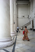 A woman out of the Grand Post Office in BBD Bagh in Kolkata, West Bengal  on Friday, May 26, 2017. Photographer: Sanjit Das