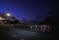 Runners at dawn in Hawaii Kai at the Honolulu Marathon