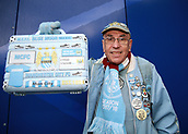 30th September 2017, Stamford Bridge, London, England; EPL Premier League football, Chelsea versus Manchester City; Fanatic Manchester City fan poses outside Stamford Bridge before kick off with custom made light blue briefcase