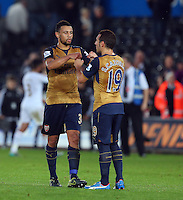 Arsenal centre midfielders Francis Coquelin and Santi Cazorla celebate at full time during the Barclays Premier League match between Swansea City and Arsenal played at The Liberty Stadium, Swansea on October 31st 2015