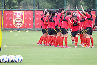 14th May 2020, Suzhou, southeastern Jiangsu Province of East China;  Players of Chinas womens national football team cheer up each other prior to an open training session in Suzhou, east China s Jiangsu Province, May 14, 2020.