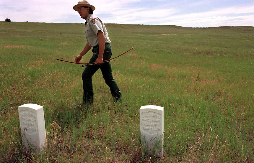 Ranger Michael Marshall picks up arrows on the Little Bighorn Battlefield after he fired them during a demonstration offered to tourists of the arms and tactics of Custer's fateful 1876 battle. Marshall is himself a Lakota Sioux Indian and the great grandson of two warriors who fought against Custer's troops.