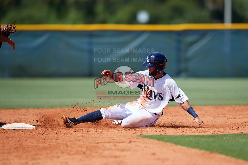 GCL Rays second baseman Cristhian Pedroza (19) slides into second base during a game against the GCL Twins on August 9, 2018 at Charlotte Sports Park in Port Charlotte, Florida.  GCL Twins defeated GCL Rays 5-2.  (Mike Janes/Four Seam Images)