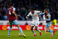 Leroy Fer of Swansea City is tackled by Steven Defour of Burnley during the Premier League match between Burnley and Swansea City at Turf Moor, Burnley, England, UK. Saturday 18 November 2017