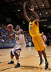 SIOUX FALLS, SD - MARCH 11:  Trayvonn Wright #32 of North Dakota State leaps to defend against the shot of Adam Link #33 of Western Illinois during their 2013 Summit League semifinal game Monday at the Sioux Falls Arena. (Photo by Dick Carlson/Inertia)