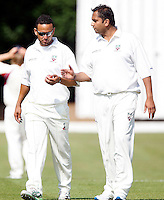 Hornsey captain Chetan Patel (R) and Paul Weekes in discussion during the Middlesex County Cricket League Division Two game between Hornsey and Harrow Town at Tivoli Road, Crouch End on Sat Sept 3, 2011