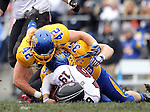 BROOKINGS, SD - OCTOBER 5:  R.C. Kilgore #42 and T.J. Lalley #33 from South Dakota State University bring down Kory Faulkner #19 from Southern Illinois in the first quarter Saturday afternoon at Coughlin Alumni Stadium in Brookings. (Photo by Dave Eggen/Inertia)