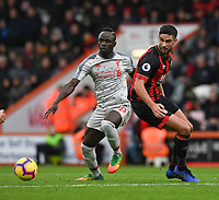 Bournemouth's Andrew Surman (right) battles with Liverpool's Sadio Mane (left) <br /> <br /> Photographer David Horton/CameraSport<br /> <br /> The Premier League - Bournemouth v Liverpool - Saturday 8th December 2018 - Vitality Stadium - Bournemouth<br /> <br /> World Copyright © 2018 CameraSport. All rights reserved. 43 Linden Ave. Countesthorpe. Leicester. England. LE8 5PG - Tel: +44 (0) 116 277 4147 - admin@camerasport.com - www.camerasport.com