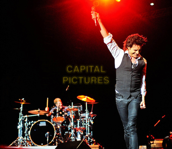 Train -  Patrick Monahan.SHOW-ME Music and Arts Festival, a three-day extravaganza featuring some of today's top musical acts held at Springfield Underground Inc., Springfield, MO, USA..June 18th, 2011.stage concert live gig performance music full length white shirt grey gray waistcoat jean denim arm in air.CAP/ADM/RP.©Ryan Pavlov/AdMedia/Capital Pictures.