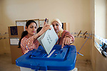 KIRKUK, IRAQ: A Kurdish woman casts her ballot...Residents of the city of Kirkuk vote for the first time.  Because of violence in the ethnically mixed city, Kirkuk was excluded from the 2005 elections...Photo by Kamaran Najm/Metrography