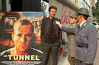 Two fake VOPO's (the infamous East German soldiers)check  director  Roland Suso Richter credentials,  beside a recreation of the Berlin Wall outside   the Imperial Cinema  in Montreal, CANADA,  <br /> Where the Movie `` The Tunnel `` (Der Tunnel) is beeing shown in the World Film Festival Competition, August 31, 2001<br /> <br /> The movie directed by Roland Suso Richter tell the story of East-Germans who dug a tunnel uner the Berlin Wall.<br /> <br /> Photo by Pierre Roussel /Getty News Images Service (ON SPEC)<br /> <br /> NOTE : raw jpeg from Nikon D 1, openened with QUIMAGE ICC profile
