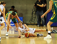 Ferns forward Georgina Richards (grounded) tries to claim the ball after a tussle with Hollie Grima during the International women's basketball match between NZ Tall Ferns and Australian Opals at Te Rauparaha Stadium, Porirua, Wellington, New Zealand on Monday 31 August 2009. Photo: Dave Lintott / lintottphoto.co.nz