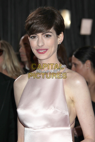 Anne Hathaway (wearing Prada).85th Annual Academy Awards held at the Dolby Theatre at Hollywood & Highland Center, Hollywood, California, USA..February 24th, 2013.oscars half length  pink sleeveless silk satin jewel encrusted embellished dress.CAP/ADM/RE.©Russ Elliot/AdMedia/Capital Pictures.