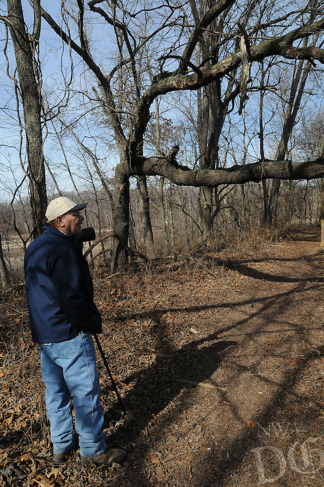NWA Democrat-Gazette/FLIP PUTTHOFF <br /> Trees with unusual shapes can be seen along the Eagle Watch Nature Trail. The first part of the trail is in a meadow along a creek. The path enters a forest near the end of the path. Stanfill walks the trail Feb. 10 2017.