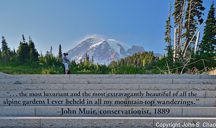 Tourist couple with child on inscribed John Muir Steps below Mount Rainier, Mount Rainier National Park, Washington State