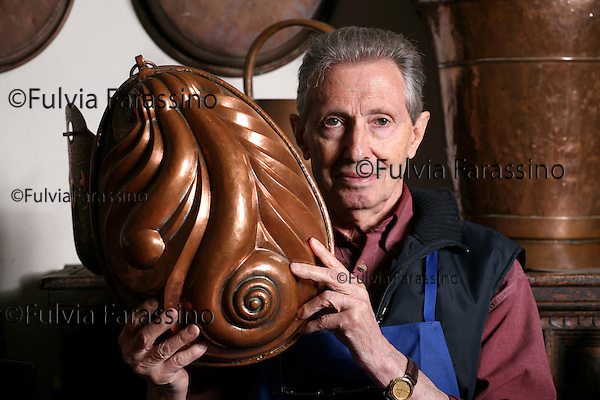 Ravina (TN) 21 April 2008.Pierino Navarini, artigiano del rame nel suo laboratorio, craftsman's copper in his workshop
