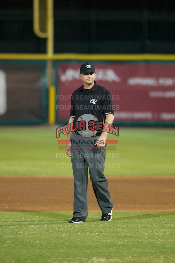 Field umpire Pete Talkington handles the calls on the bases during game between the AZL Rangers and the AZL Giants on August 22 at Scottsdale Stadium in Scottsdale, Arizona. AZL Rangers defeated the AZL Giants 7-5. (Zachary Lucy/Four Seam Images via AP Images)