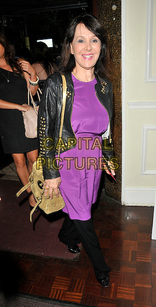 ARLENE PHILLIPS.'Burn  the Floor' Press Night at the Shaftesbury Theatre, London, England..July 26th 2010.full length black leather jacket purple dress trousers bag studs studded beige.CAP/CAN.©Can Nguyen/Capital Pictures.
