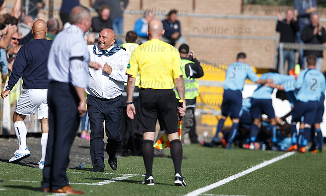 Forfar manager Dick Campbell dancing on the sidelines as he celebrates the winning goal putting Rangers out of the league cup in the first round
