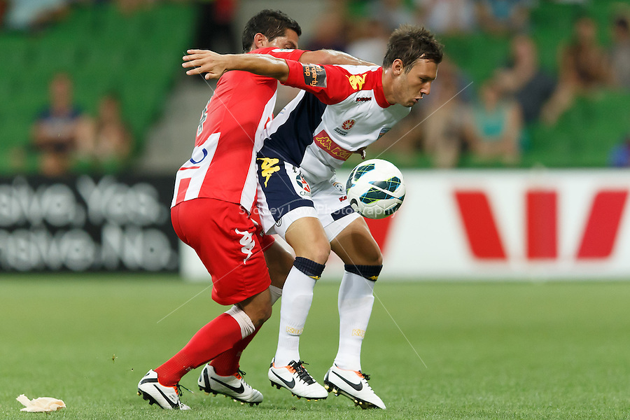 MELBOURNE - 11 MAR: Simon COLOSIMO of the Heart and Fabian BARBIERO of Adelaide fight for the ball in the round 24 A-League match between Melbourne Heart and Adelaide United at AAMI Park on 11 March 2013. (Photo Sydney Low/syd-low.com/Melbourne Heart)