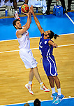 French national basketball team player Joakim Noah blocking Pau Gasol during final Eurobasket 2011 game between Spain and France in Kaunas, Lithuania, Sunday, September 18, 2011. (photo: Pedja Milosavljevic)