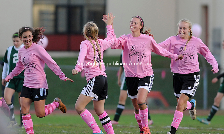 TORRINGTON, CT-11 OCTOBER2012--10112JS20--Torrington's Olivia Morrison (9) third from left, is congratulated by teammates after scoring a goal in their 2-0 win over Holy Cross Thursday at Torrington High School. .Jim Shannon Republican-American