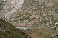 A flat plain forms between steep valley sides, Mont Blanc, September 2007