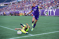 Orlando, Florida - Sunday, May 8, 2016: Orlando Pride forward Alex Morgan (13) has her crossing attempt defended by Seattle Reign FC defender Lauren Barnes (3) during a National Women's Soccer League match between Orlando Pride and Seattle Reign FC at Camping World Stadium.