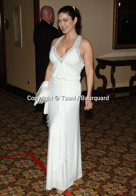 Laura Herring arriving at the 58th Director Guild Awards at the Hyatt Century Plaza Hotel In Los Angeles.<br /> <br /> full length<br /> smile<br /> eye contact<br /> white dress