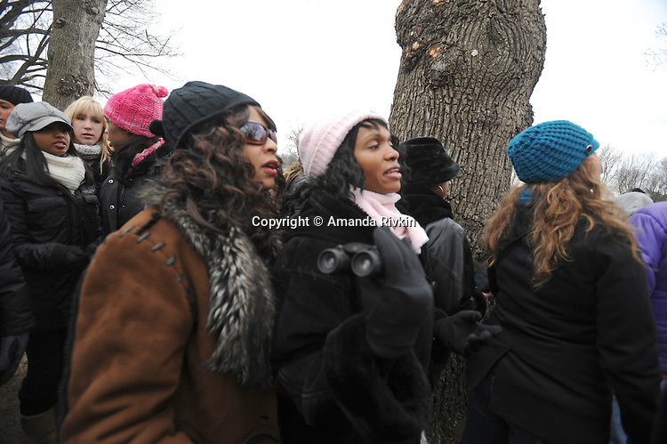 """Women gather to watch the """"We Are One"""" concert in celebration of Barack Obama's inauguration as president of the United States at the Lincoln Memorial in Washington DC on January 18, 2009."""