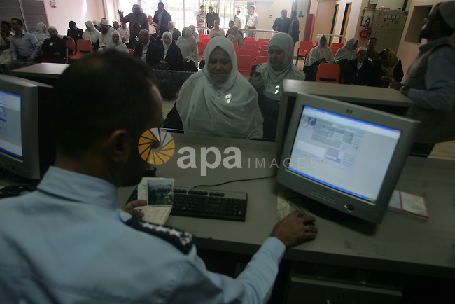Palestinian pilgrims wait to cross the Rafah border crossing into Egypt , in the southern Gaza Strip town of Rafah on Nov. 3,2010 . Hundreds of Palestinian pilgrims crossed into Egypt on their way to Saudi Arabia to perform the annual Muslim Hajj pilgrimage. Photo by Khaled Khaled