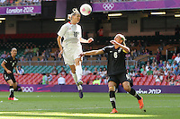 Kelly SMITH of Great Britain rises above Rebecca SMITH of New Zealand - Great Britain Women vs New Zealand Women - Womens Olympic Football Tournament London 2012 Group E at the Millenium Stadium, Cardiff, Wales - 25/07/12 - MANDATORY CREDIT: Gavin Ellis/SHEKICKS/TGSPHOTO - Self billing applies where appropriate - 0845 094 6026 - contact@tgsphoto.co.uk - NO UNPAID USE.