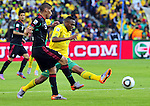 11 June 2010, South African Kagisho Dikgacoi attempts to stop Mexican Carlos Salcido in the opening game of the 2010 Fifa World Cup between South Africa and Mexico at the Soccer City stadium in Johannesburg. The game ended in a one all draw. Picture: Shayne Robinson
