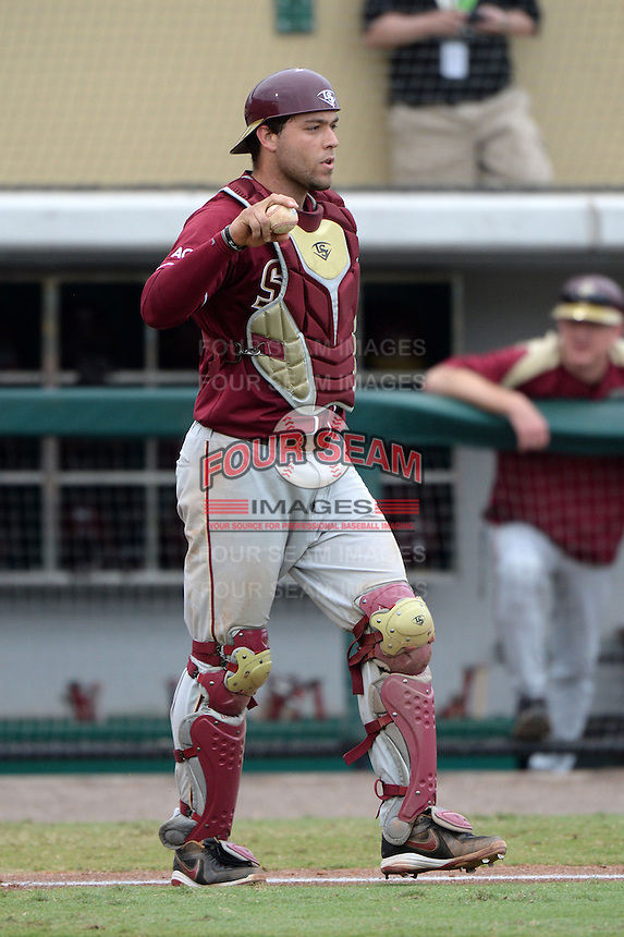 Florida State Seminoles catcher Danny De La Calle (13) during a game against the South Florida Bulls on March 5, 2014 at Red McEwen Field in Tampa, Florida.  Florida State defeated South Florida 4-1.  (Mike Janes/Four Seam Images)